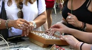 Female hands selecting and trying jewelry and ring Stock Footage