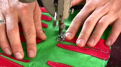 Stock Video Footage of Hands of tailor sewing backgammon game