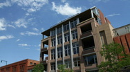 Clouds over Modern Apartment Building Time Lapse Stock Footage