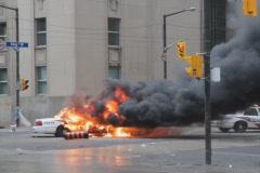 G20 Toronto. Burning police car. 2 shots. SD. Stock Footage