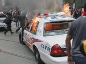 G20 Toronto. Burning police car. SD. Stock Footage