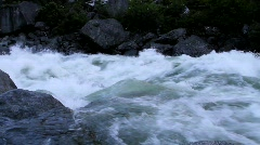 A river pours over rapids in Central Washington State. Stock Footage