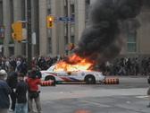 G20 Toronto. Burning police car explosions. SD. Stock Footage