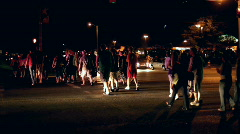 Large Group of people crossing street at night Stock Footage