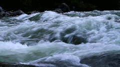 Rushing river water cascades over rocks - stock footage