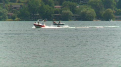 Motorboat towing tube on a warm summer day Stock Footage