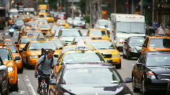 Busy street with cabs and pedestrians - stock footage