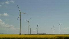 Wind Turbines, in a Rape Seed field, N.E. Germany  Stock Footage