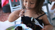 Stock Video Footage of little girl eating cake