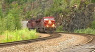 Railroad, freight train rounding corner, head on, nice Stock Footage