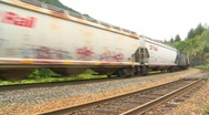 Railroad, freight train, cars covered in graffiti  Stock Footage