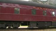 Railroad, heavyweight passenger cars creeping along track Stock Footage