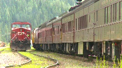 Railroad, heavyweight passenger cars slow with AC4400 Stock Footage