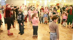 Adults hold competitions with participation of children in hallway of circus. Stock Footage