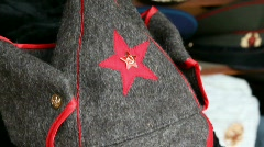 Many souvenir military caps with Soviet and Russian symbols and budenovka in Stock Footage