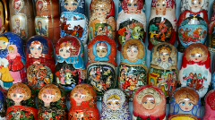 Many souvenir Russian wooden dolls, which are called Matryoshka are on counter Stock Footage