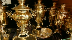 Shop with polished to golden samovars and faceted glass in metal holders Stock Footage