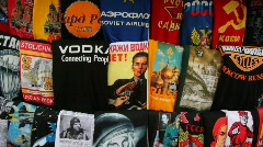 Shelving russian T-shirts with symbols of country in kiosk for tourists Stock Footage