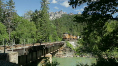 Union Pacific freight train, Castle Crags, and creek Stock Footage