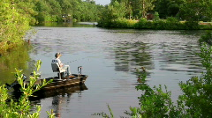 Boy fishing in boat  571 Stock Footage