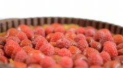 Raspberries falling on the fruit tart Stock Footage