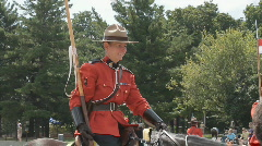 Female RCMP Police Officer Of The Musical Ride Wearing Red Traditional Uniform Stock Footage