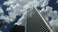 Skyscraper with Fast Clouds Time Lapse Stock Footage