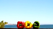 Stock Video Footage of Three Chilli Peppers and The Ocean