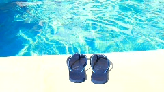 Swimming-Pool and Blue Flip-Flops Stock Footage