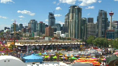 Pan, stampede grounds and downtown skyline Stock Footage