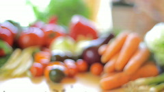 Table full of vegetables, dolly shot Stock Footage