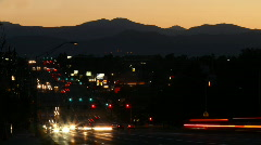 Night Traffic with Rocky Mountains Time Lapse Stock Footage