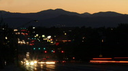 Stock Video Footage of Night Traffic with Rocky Mountains Time Lapse