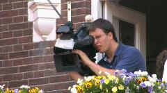 Cameraman setting up his camera - stock footage