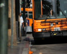 City Bus Departs 01 PAL - stock footage