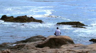 Man on cell phone by ocean V2 - HD Stock Footage