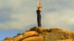 Yoga on boulder zoom out - HD - stock footage