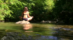 Meditation on a river zoom out - HD Stock Footage