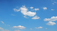 White clouds flying on blue sky - motion background time-lapse Stock Footage