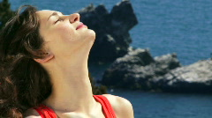 Woman basking in the sun Stock Footage