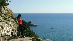 Girl on the edge of the cliff Stock Footage