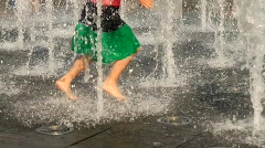 Children going through fountain - HD 1920 X 1080 - stock footage
