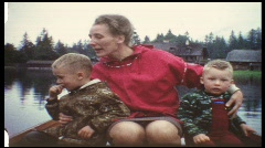 Mother with children on mountain lake (vintage 8 mm amateur film) Stock Footage