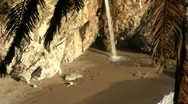 Waterfall on pristine beach V1 - HD Stock Footage