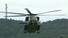 Military transport helicopter landing Stock Footage
