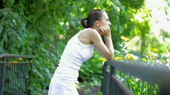 Pensive woman standing on the bridge - stock footage