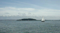 Sailboat with long island bridge Stock Footage