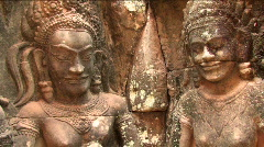 Stock Video Footage of Bas Reliefs Sculpture RUINED TEMPLE Angkor Wat Cambodia Gods Asia Art Hindu
