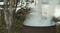 Burning leaves in a barrel 1 Stock Footage