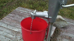 Filling bucket with water from artesian well 1 Stock Footage